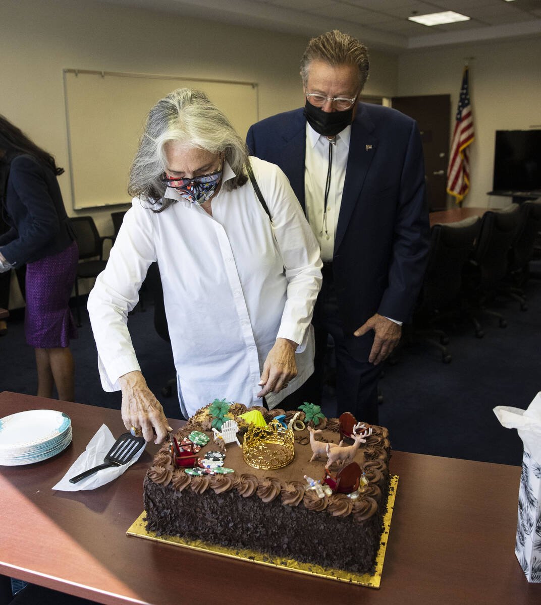 John Moran, chairman of the Nevada Gaming Commission, watches as his wife Marilyn cuts a custom ...
