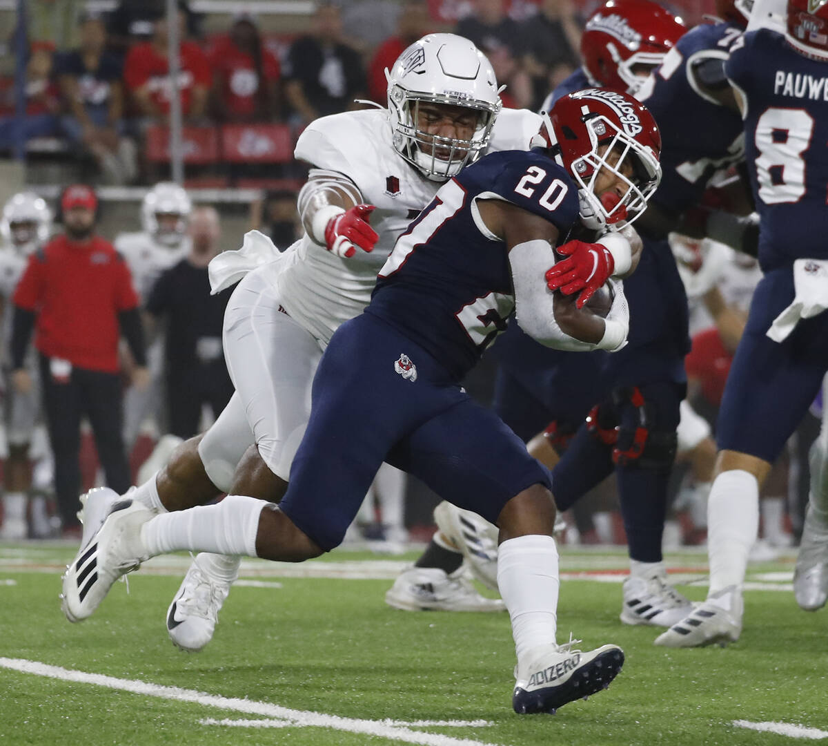 UNLV linebacker Kylan Wilborn wraps up Fresno State running back Ronnie Rivers during the first ...
