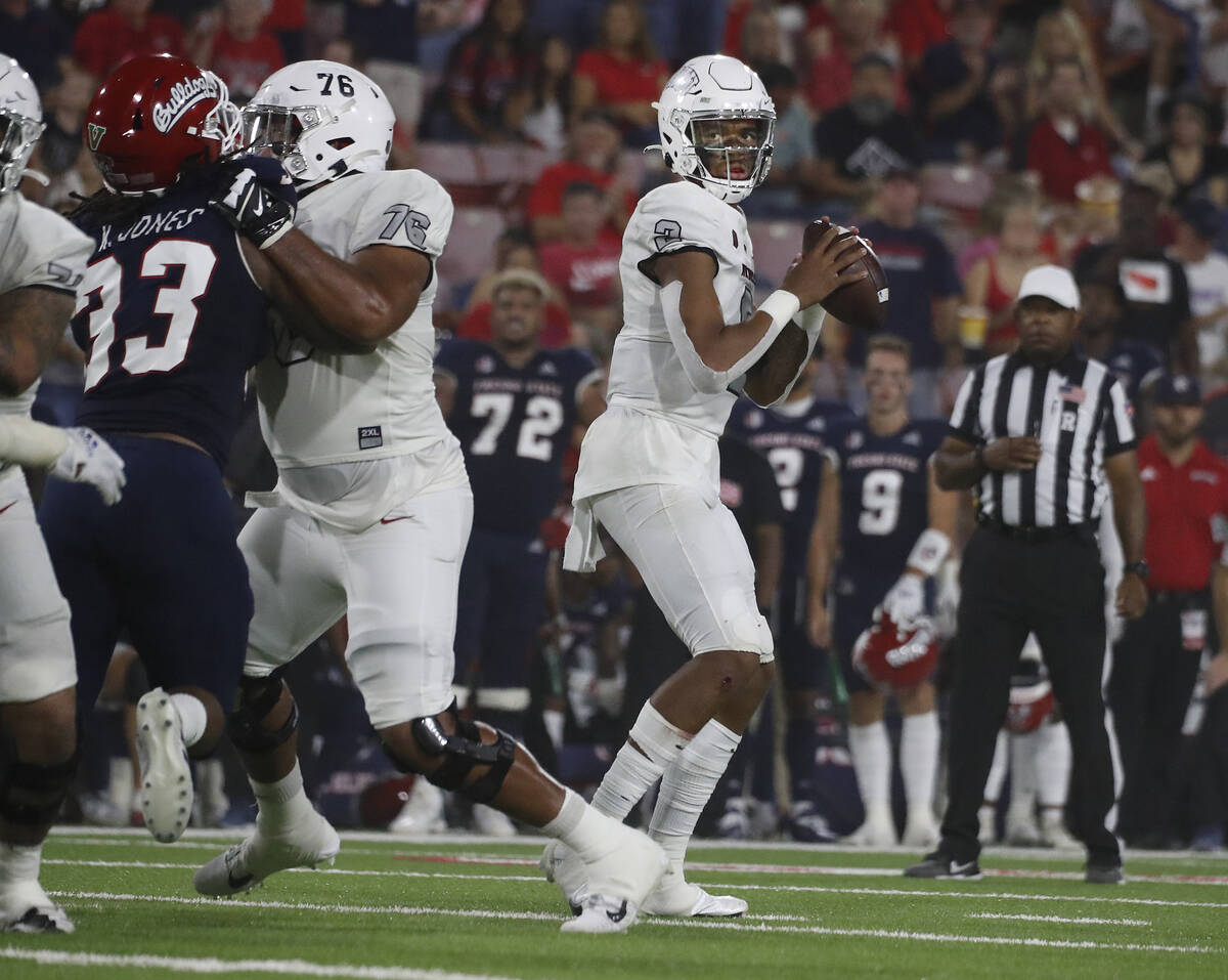 UNLV quarterback Doug Brumfield drops back to pass against Fresno State during the first half o ...