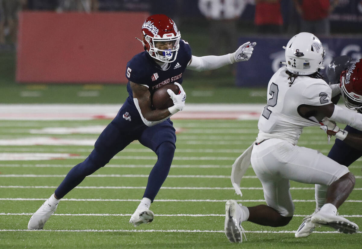 Fresno State Jalen Cropper looks to avoid UNLV defensive back Nohl Williams during the first ha ...
