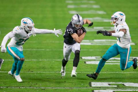 Raiders wide receiver Hunter Renfrow (13) runs after making a catch through Miami Dolphins corn ...