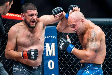 Nick Diaz, left, battles with Robbie Lawler in the third round during their welterweight fight ...