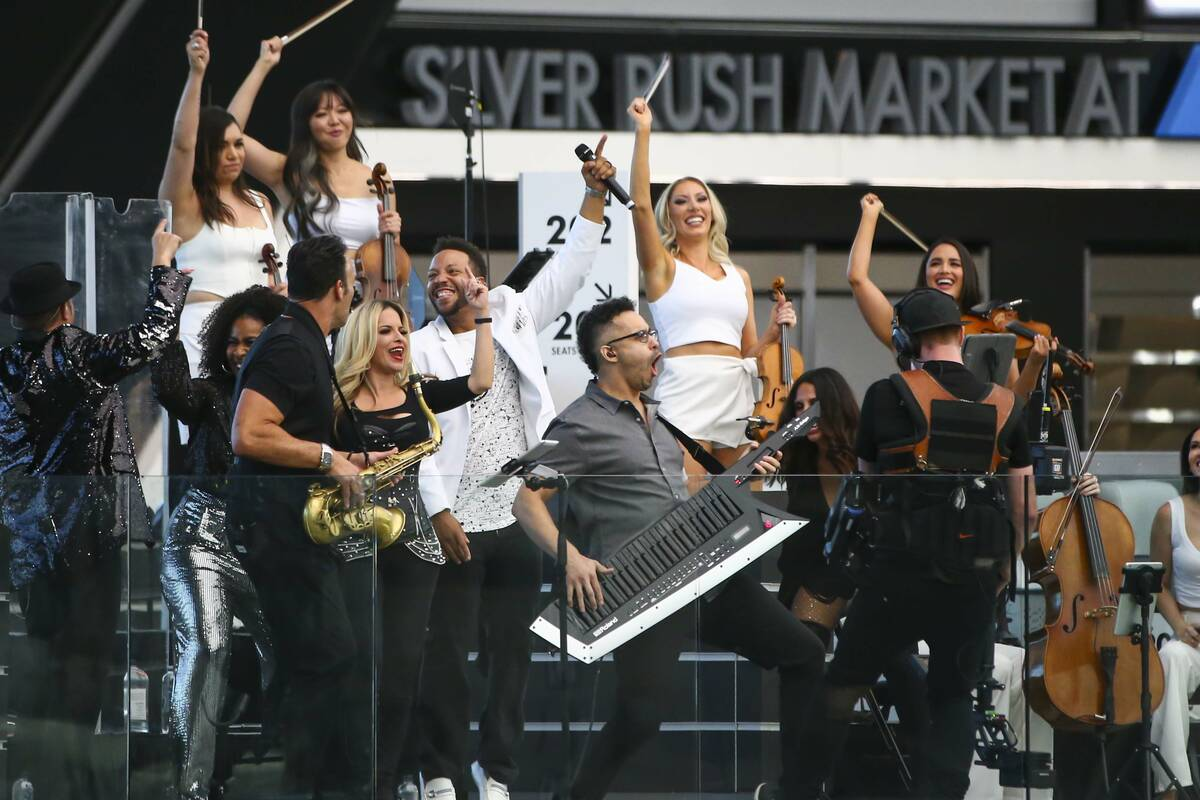 Otto Ehling (with keytar) and David Perrico's Pop Strings band perform at Allegiant Stadium in ...