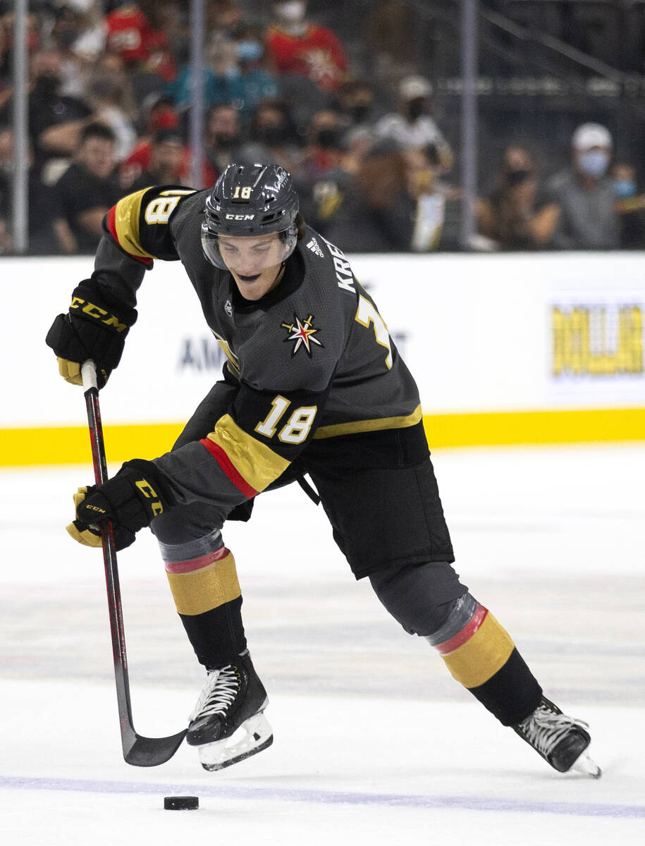 Golden Knights left wing Peyton Krebs (18) gains control of the puck during the first period of ...