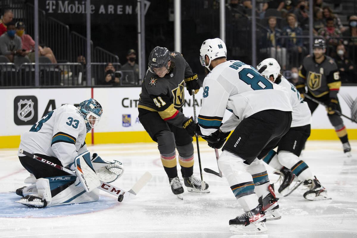 Sharks goaltender Adin Hill (33) saves a shot by Golden Knights forward Nolan Patrick (41) as S ...