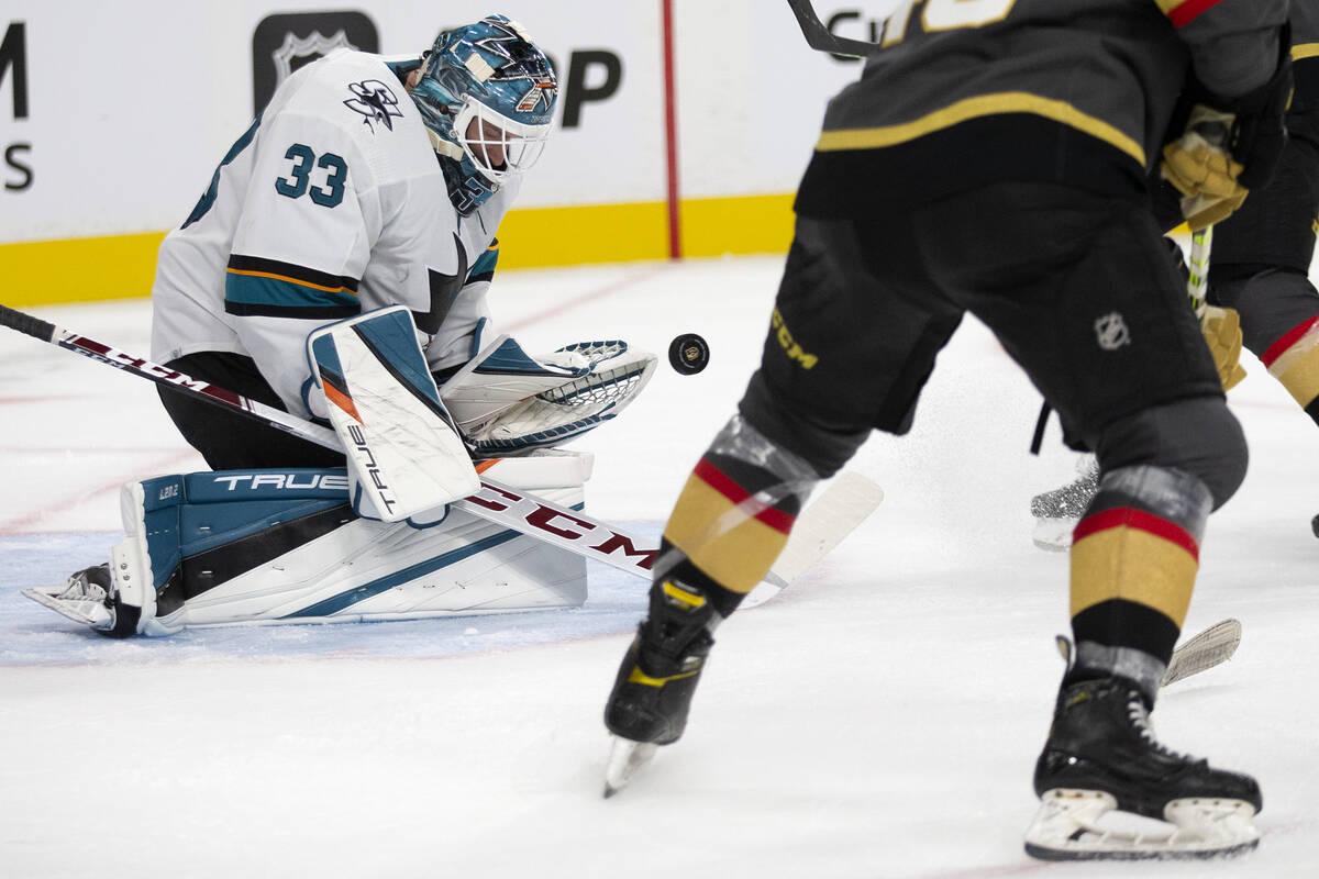 Sharks goaltender Adin Hill (33) saves a shot during the third period of a preseason NHL hockey ...