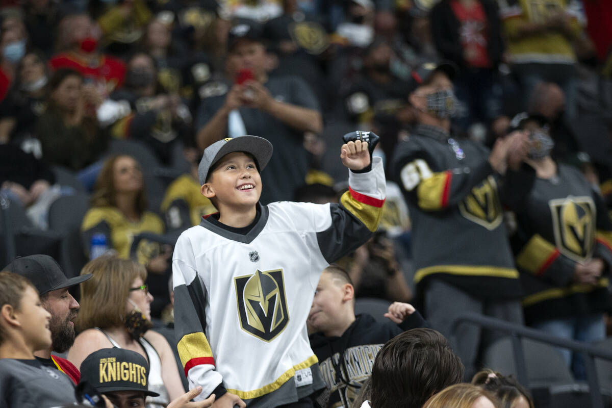 A fan dances to the big screen during a preseason NHL hockey game between the Golden Knights an ...
