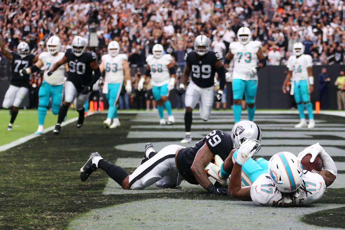 Las Vegas Raiders cornerback Casey Hayward (29) tackles Miami Dolphins wide receiver Jaylen Wad ...