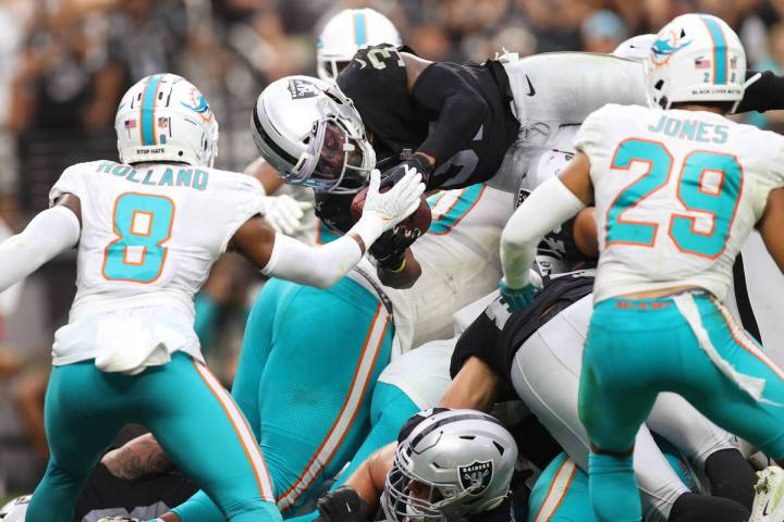 Las Vegas Raiders running back Peyton Barber (31) leaps for a touchdown in the second half of a ...