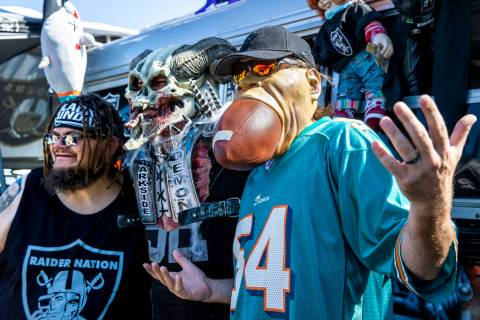 Fans gather for photos about Andy Coronado's AC12 Raider Nation Bus before the Raiders face the ...