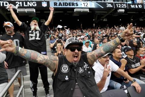 "Fans, including Jaime ""Raider Rico"" Rico of Las Vegas, center, and Mark Pimentel of S ..."