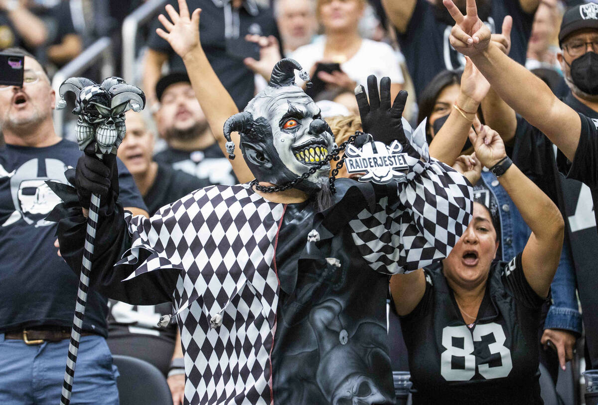 The Raiders Jester with other fans in the stands during the first half of their NFL game versus ...