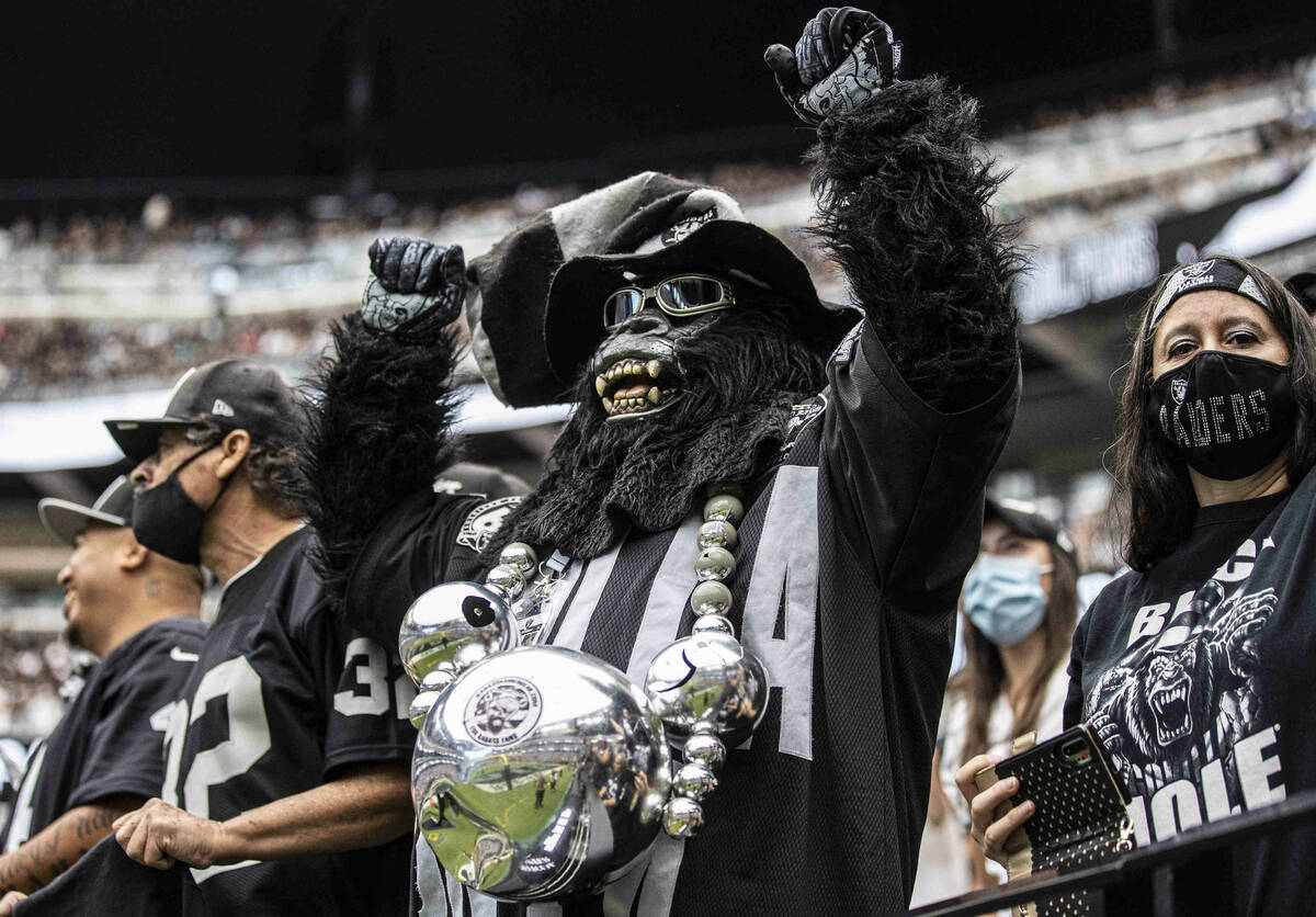 Raiders fans during an NFL football game against the Miami Dolphins on Sunday, Sept. 26, 2021, ...
