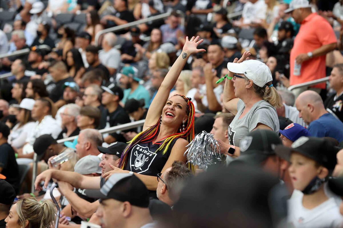 Fans, including Kali Jones of Las Vegas, left, and Cathy Pilkington of Canada, cheer as the Rai ...