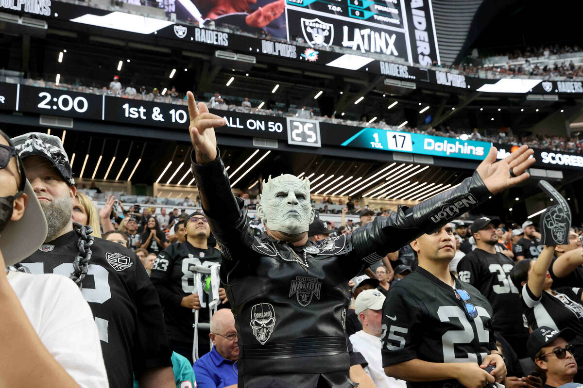 "Fans, including Dave ""Raider White Walker"" Bradford of Ft. Lauderdale, Fl., cheer as ..."