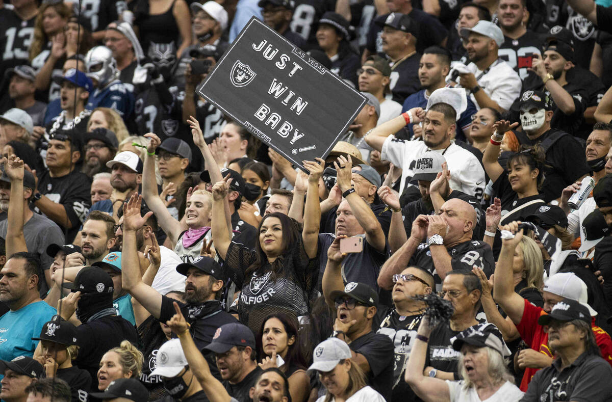 Raiders fans in the stands during the second half of their NFL game versus the Miami Dolphins a ...