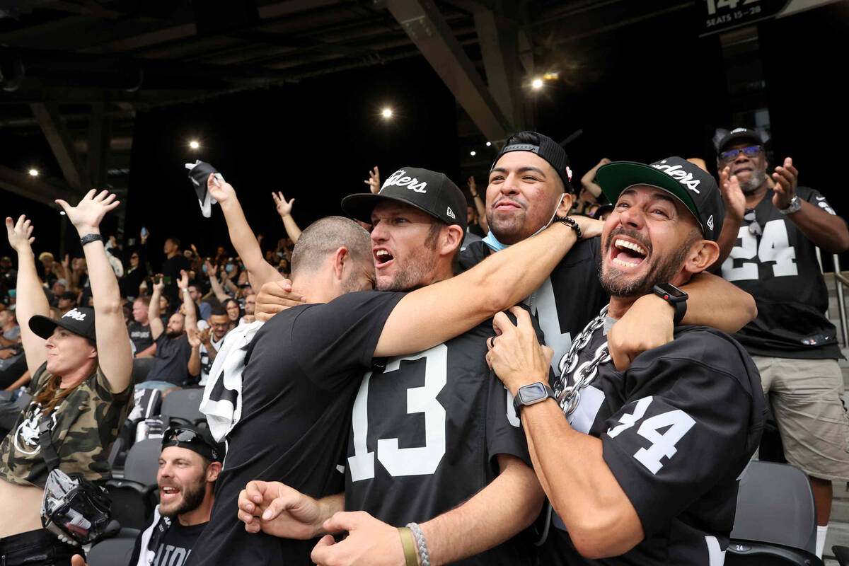 Fans, including, from right, Rob Lujan of Las Vegas, Ivan Castro of San Leandro, Erik Wood of L ...