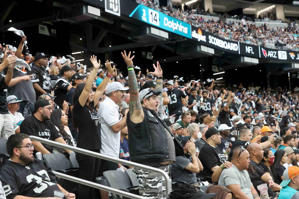 "Fans, including Jaime ""Raider Rico"" Rico of Las Vegas, center, cheer as the Raiders t ..."