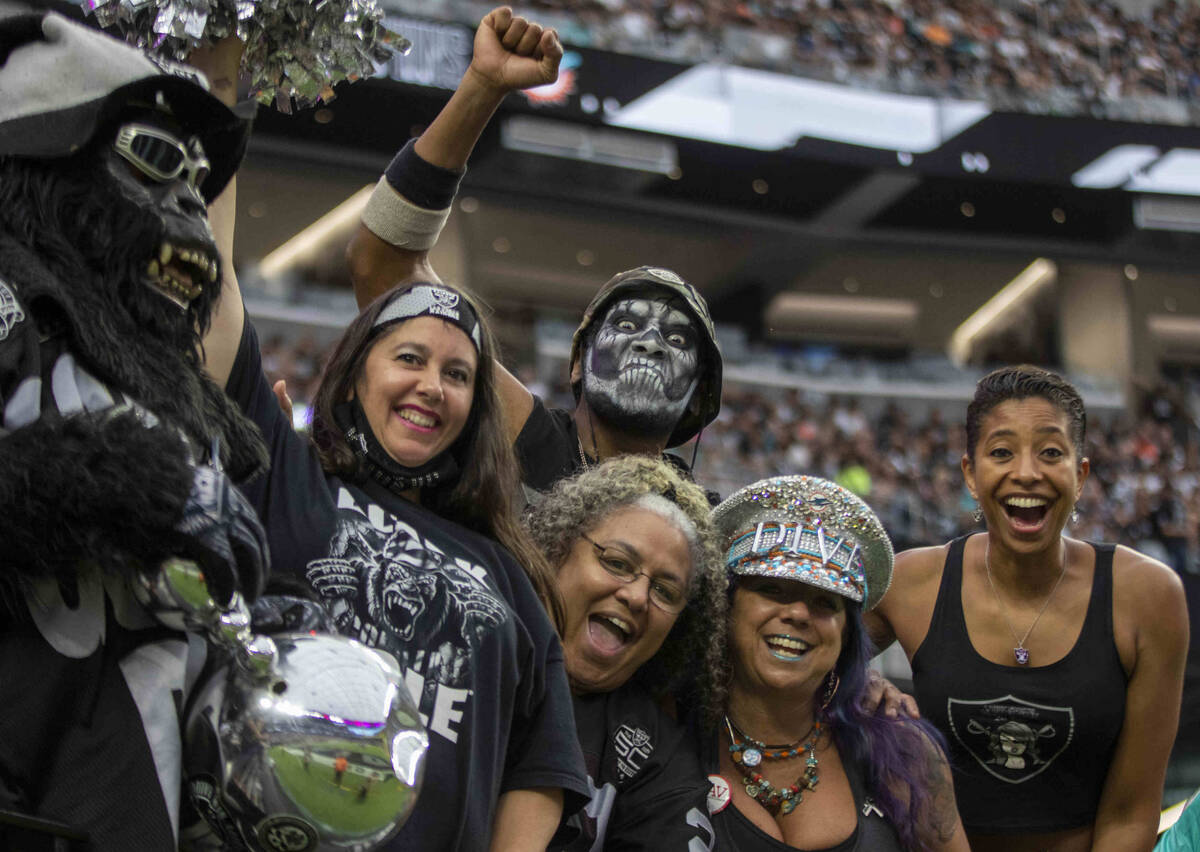 Raiders fans cheer during the fourth quarter of an NFL football game against the Miami Dolphins ...
