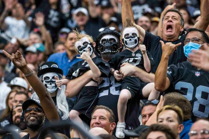 Raiders fans cheer on the team versus the Miami Dolphins in the first half of their NFL game at ...