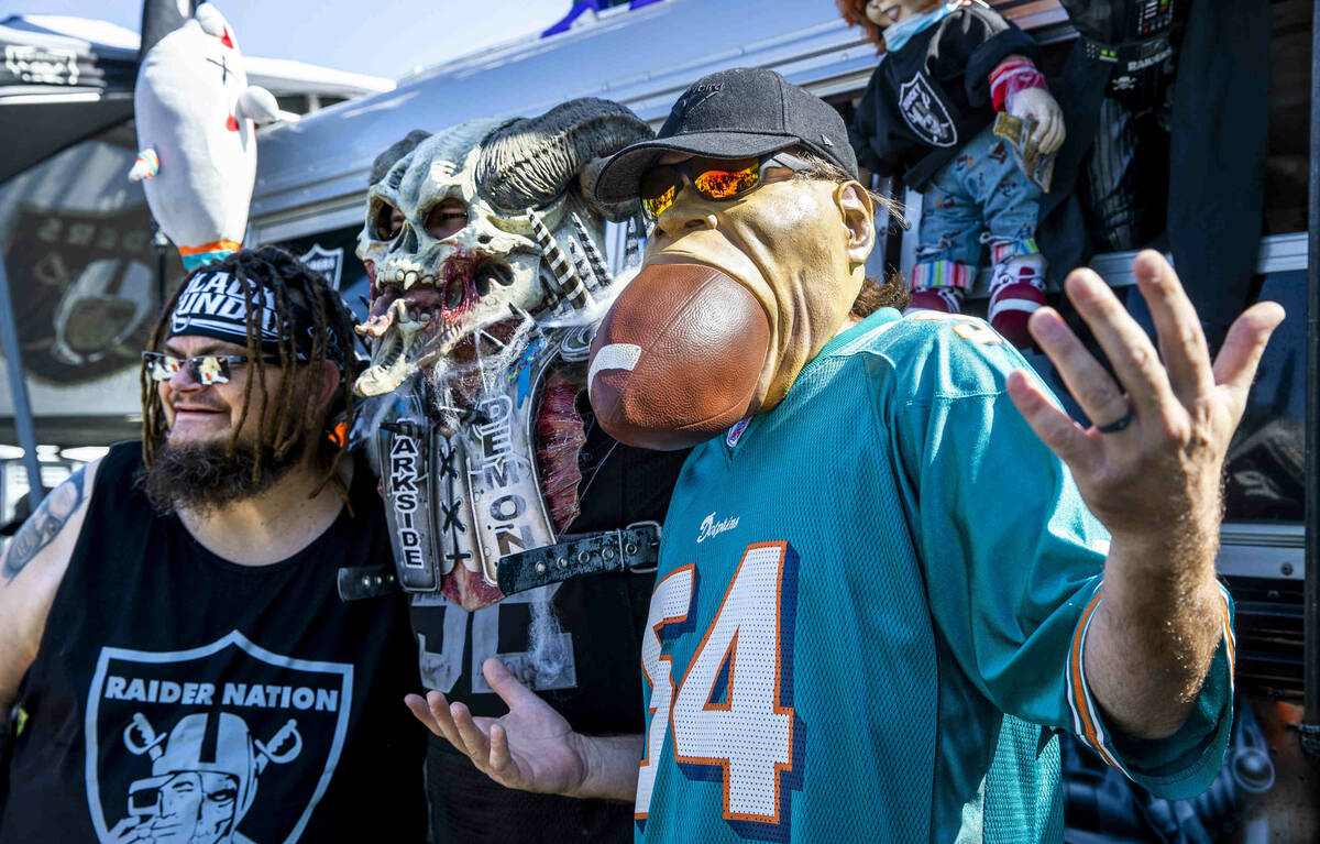 Fans gather for photos about Andy CoronadoÕs AC12 Raider Nation Bus before the Raiders fac ...