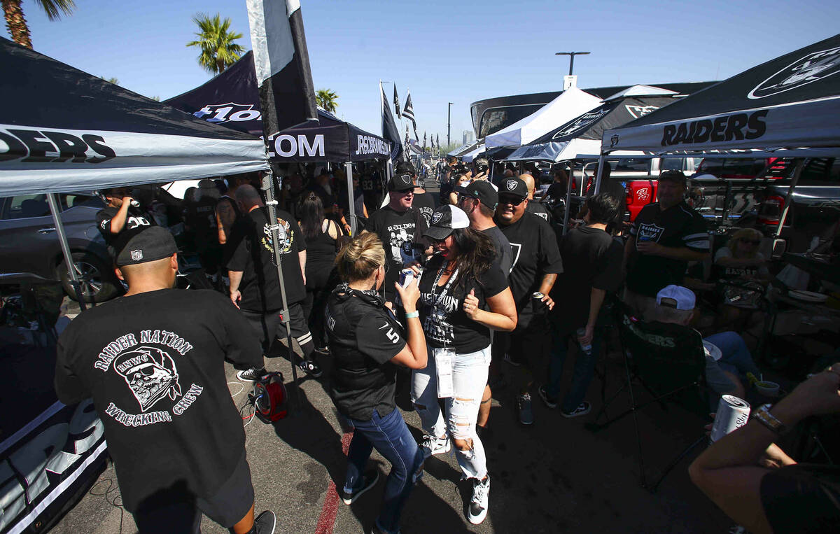 Raiders fans dance and tailgate before an NFL game between the Raiders and Miami Dolphins at Al ...