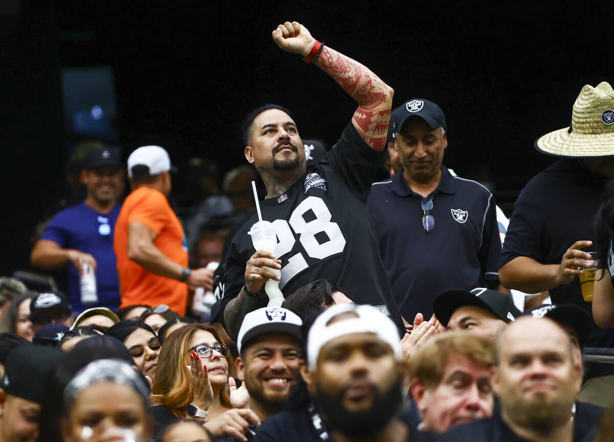 Raiders fans cheer during the second half of NFL game against the Miami Dolphins at Allegiant S ...