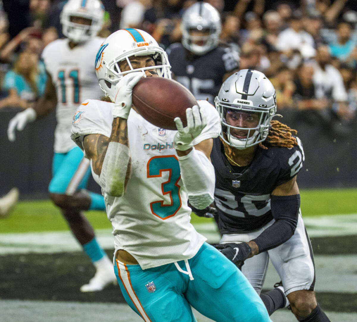Miami Dolphins wide receiver Will Fuller (3) pulls in a two-point conversion past Las Vegas Rai ...