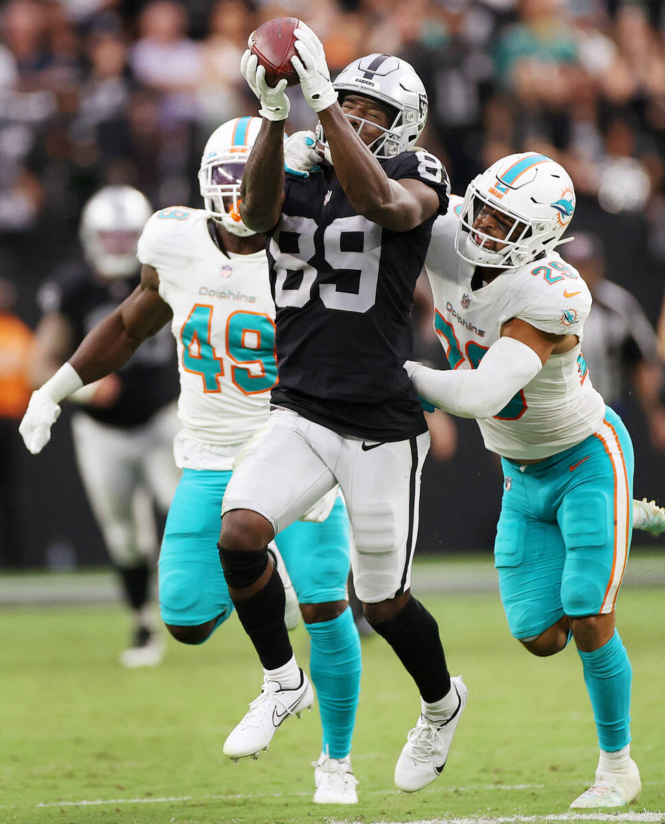 Las Vegas Raiders wide receiver Bryan Edwards (89) makes catch under pressure from Miami Dolphi ...