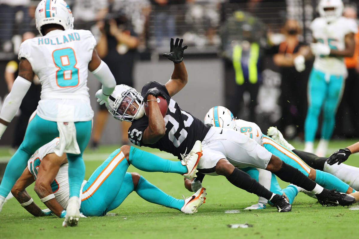 Las Vegas Raiders running back Kenyan Drake (23) is tackled short of the goal line by Miami Dol ...