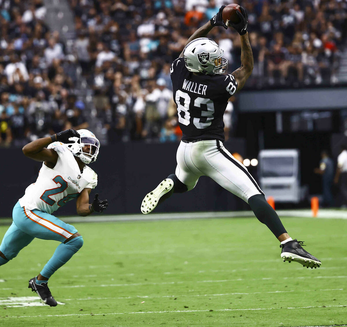 Raiders tight end Darren Waller (83) makes a reception in front of Miami Dolphins cornerback By ...
