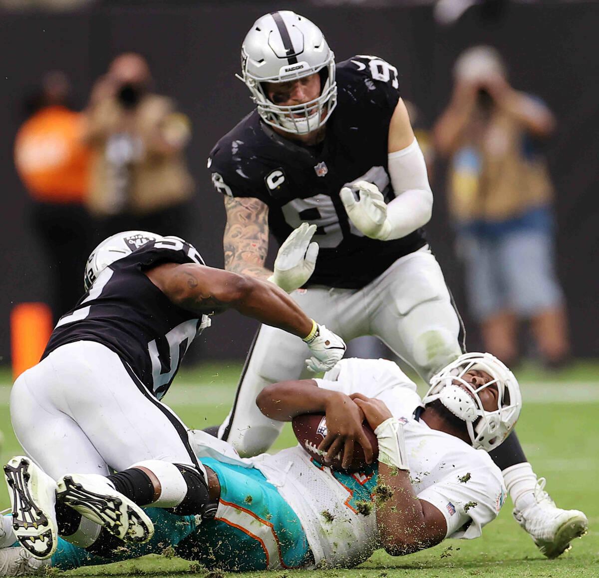Las Vegas Raiders defensive end Clelin Ferrell (99) looks on as linebacker Denzel Perryman (52) ...