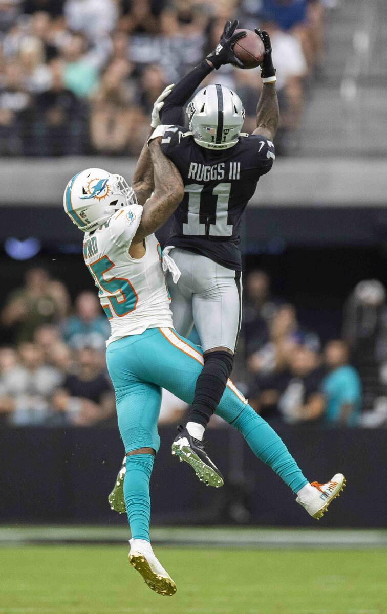 Las Vegas Raiders wide receiver Henry Ruggs III (11) makes a catch over Miami Dolphins cornerba ...