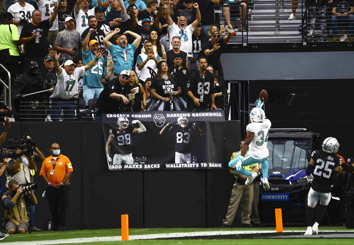 Miami Dolphins running back Malcolm Brown (34) celebrates a touchdown during the first half of ...