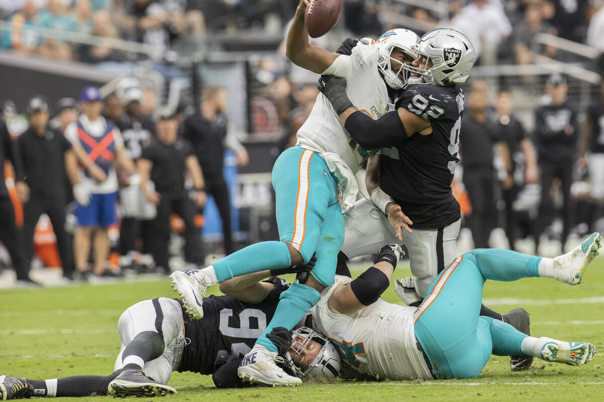 Las Vegas Raiders defensive end Carl Nassib (94) and Las Vegas Raiders defensive end Solomon Th ...