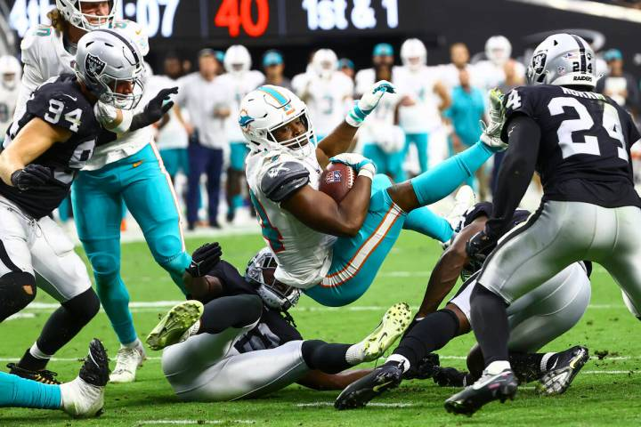 Miami Dolphins quarterback Jacoby Brissett (14) is stopped short at the end zone by the Raiders ...