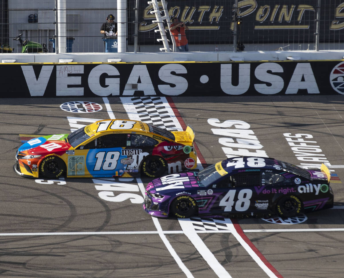 Kyle Busch (18) and Alex Bowman (48) race during the 4th Annual South Point 400 race at Las Veg ...