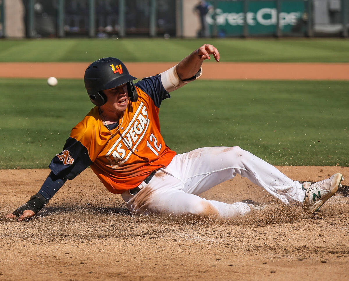 Las Vegas Aviators' Nick Allen (12) slides to make home base in a game against the Oklah ...