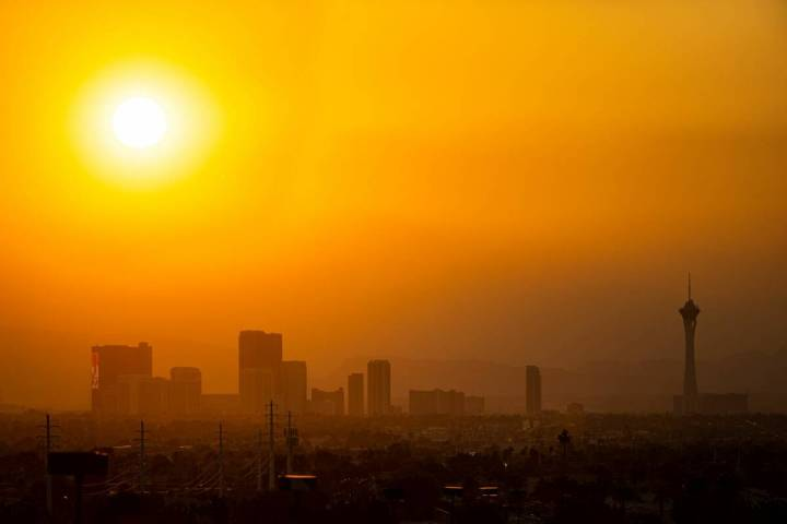 The sun shines through smoke and haze over the north end of the Las Vegas Strip in Las Vegas on ...