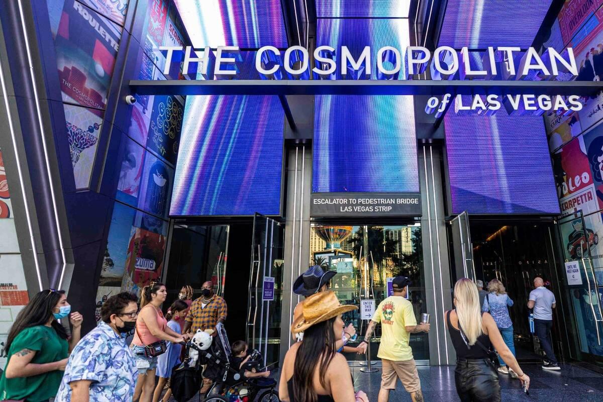 Pedestrians walk past The Cosmopolitan of Las Vegas on Monday, Sept. 27, 2021, in Las Vegas. (B ...