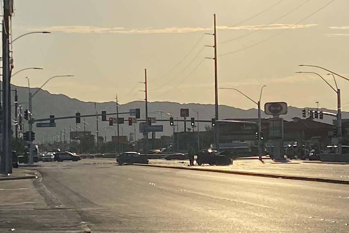 A two-vehicle crash sent multiple people to the hospital and closed an east Las Vegas intersect ...