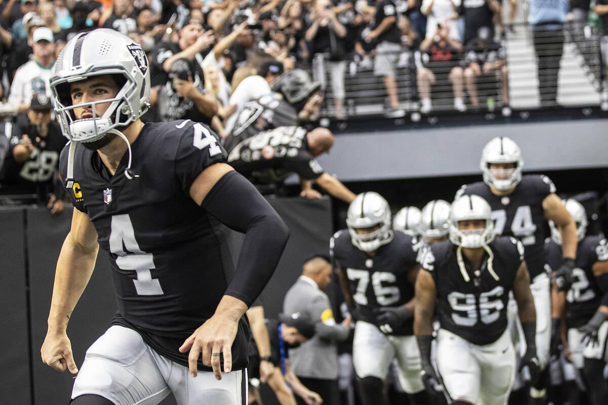 Las Vegas Raiders quarterback Derek Carr (4) leads his team on the field before the start of an ...