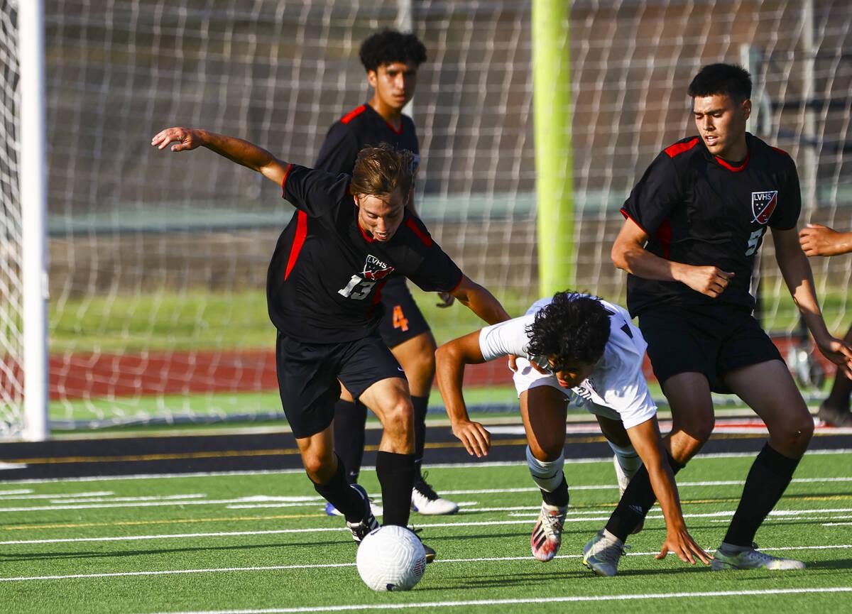 Las Vegas' Keaton McCoy (13) moves the ball as Coronado's Isaac Carcamo tries to keep up during ...
