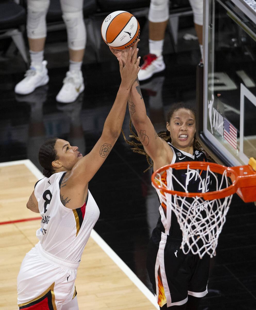 Las Vegas Aces center Liz Cambage (8) blocks a shot by Phoenix Mercury center Brittney Griner ( ...