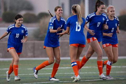 Bishop Gorman's Gabby Dilandri, second left, (9) celebrates her goal with her teammates during ...