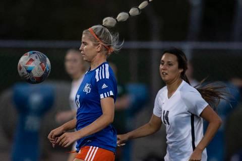 Bishop Gorman's Michelie Madrid (11) controls the ball as Palo Verde's Lauren Kinkead (14) duri ...