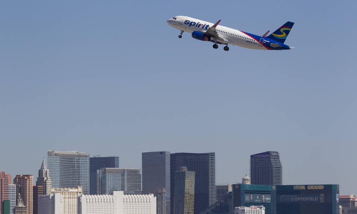 A Spirit Airlines jetliner departs McCarran International Airport in Las Vegas on Wednesday, Ju ...