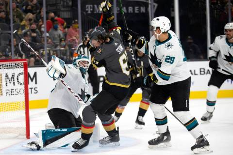 The puck is in the air after hitting the ear of Golden Knights right wing Mark Stone (61) as Sh ...