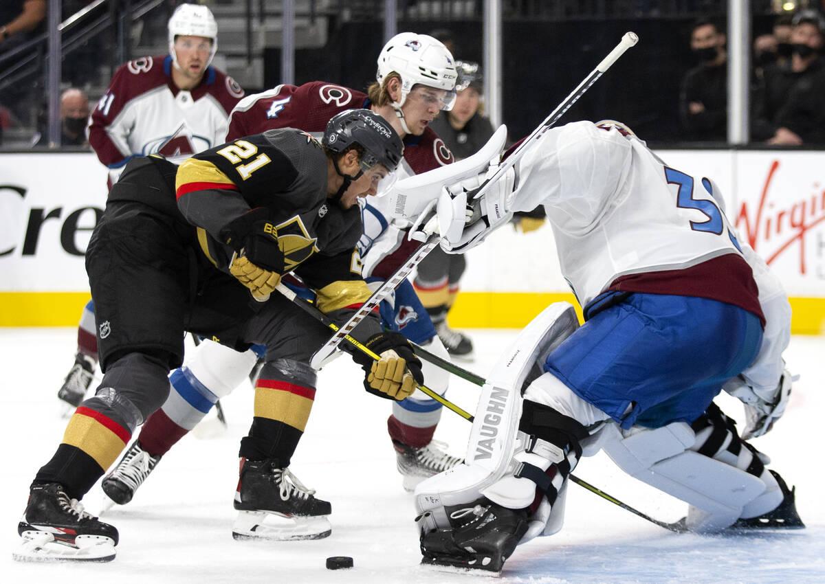 Golden Knights center Brett Howden (21) attempts a goal on Avalanche goaltender Jonas Johansson ...