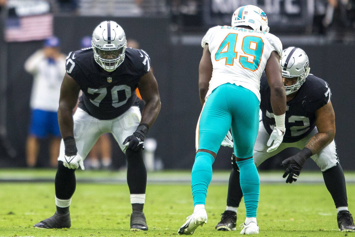 Raiders offensive tackle Alex Leatherwood (70) and Raiders offensive tackle Jermaine Eluemunor ...
